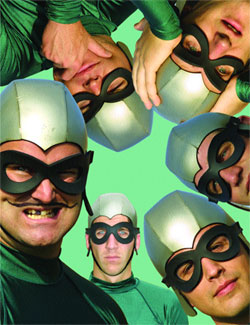 A picture of the members of the Aquabats wearing green costumes and masks with their heads rotated in a circle around the picture.